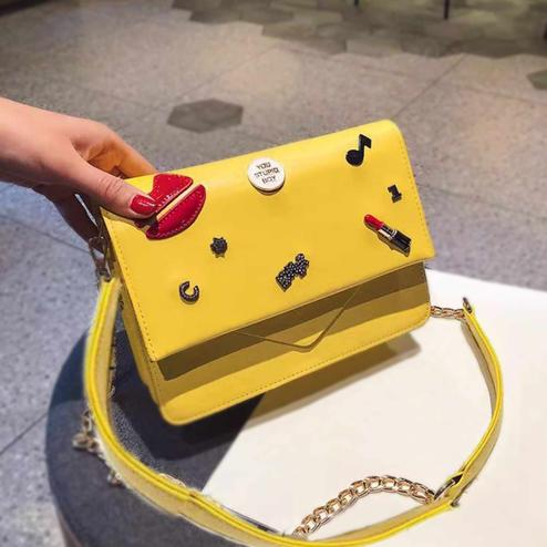 Gleaming Yellow Colored Partywear PU Leather Solid Sling Bag