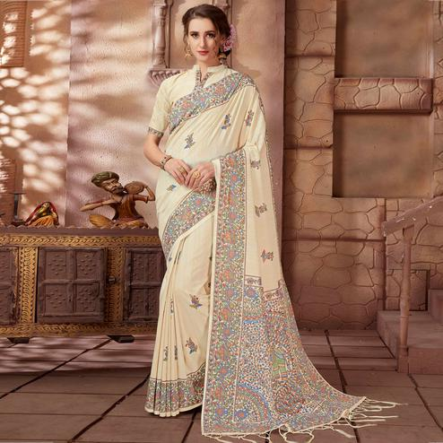 Gorgeous Cream Colored Festive Wear Madhubani Printed Art Silk Saree