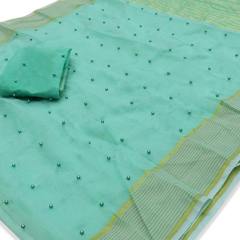 Entrancing Aqua Green Colored Party Wear Pearl Work Kota Doria Saree