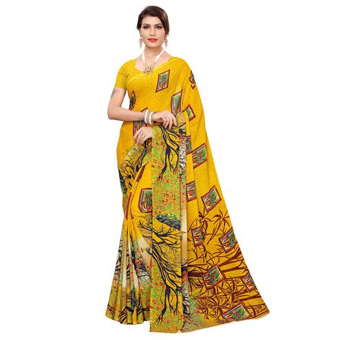 Charming Yellow Colored Casual Wear Printed Georgette Saree