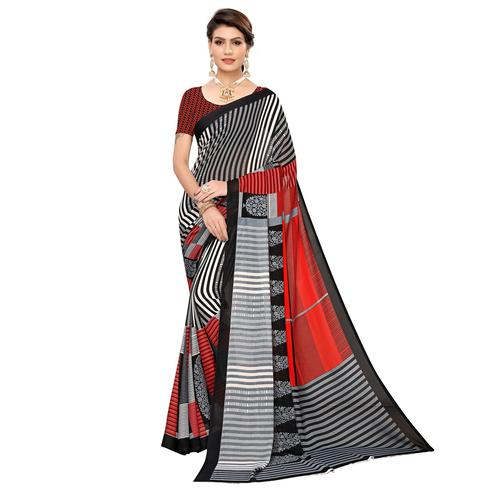 Arresting Black-White Colored Casual Wear Printed Georgette Saree