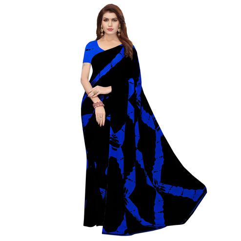 Exotic Black-Blue Colored Casual Wear Printed Georgette Saree