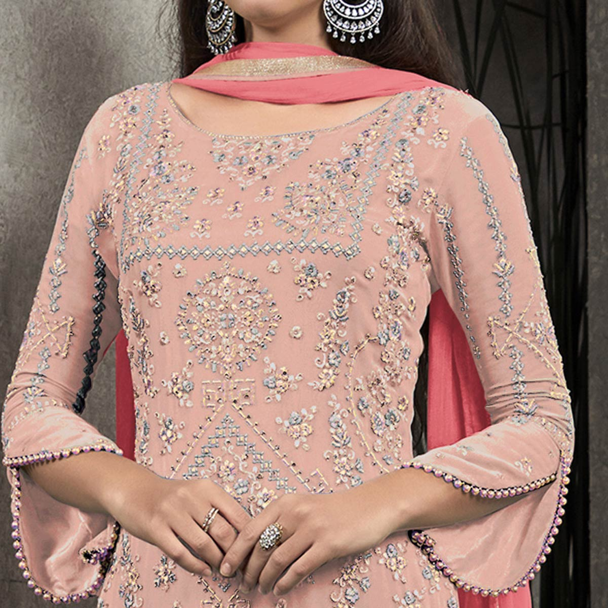 Gleaming Peach Colored Partywear Embroidered Georgette Palazzo Suit