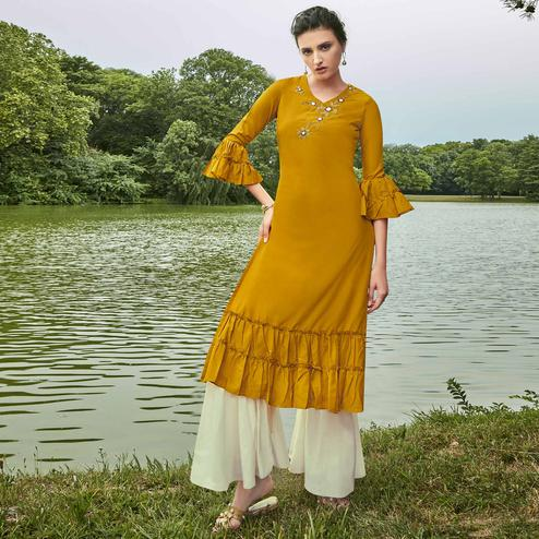 Majesty Mustard Yellow Colored Partywear Hand Embroidered Muslin Silk Kurti-Palazzo Set