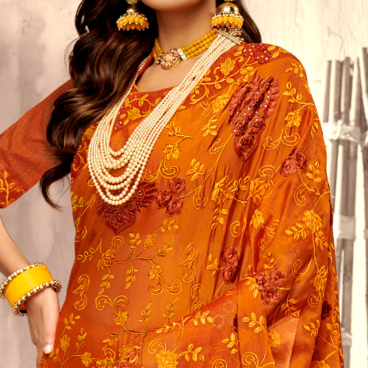 Blooming Orange Colored Party Wear Floral Embroidered Georgette Saree