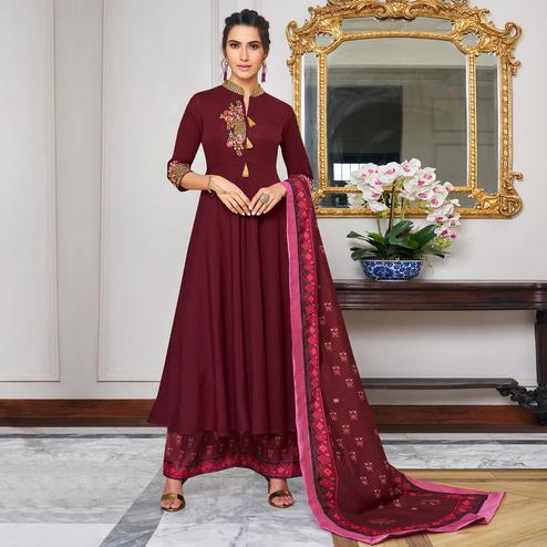 Adorning Maroon Colored Party Wear Embroidered Cotton Palazzo Suit