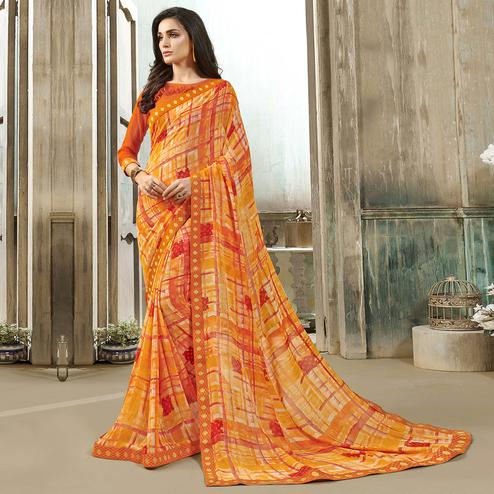 Graceful Yellow-Orange Colored Casual Wear Printed Georgette Saree