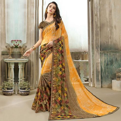 Innovative Light Orange Colored Casual Wear Printed Georgette Saree