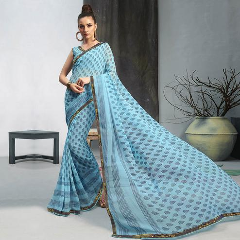 Opulent Sky Blue Colored Casual Wear Printed Georgette Saree