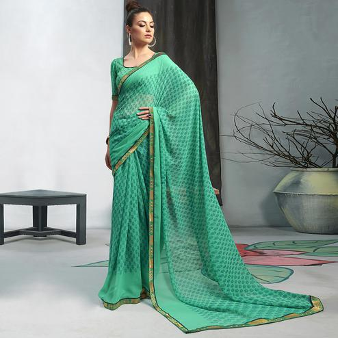 Gleaming Sea Green Colored Casual Wear Printed Georgette Saree