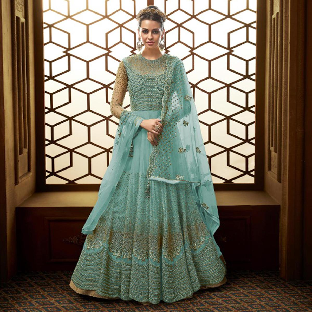 Exotic Sky Blue Colored Party Wear Embroidered Netted Anarkali Suit