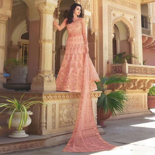 Engrossing Peach Colored Partywear Embroidered Netted Anarkali With Dual Bottom