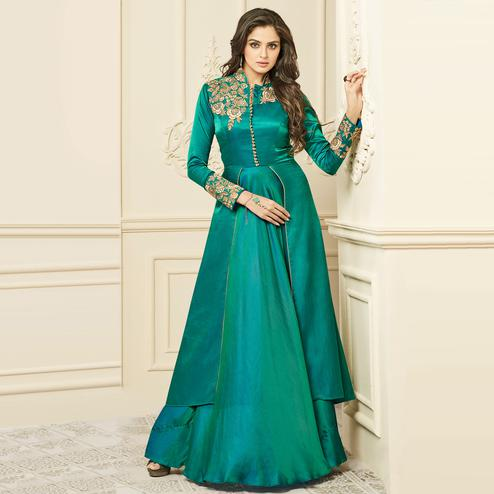 Glorious Turquoise Green Colored Party Wear Embroidered Art Silk Gown