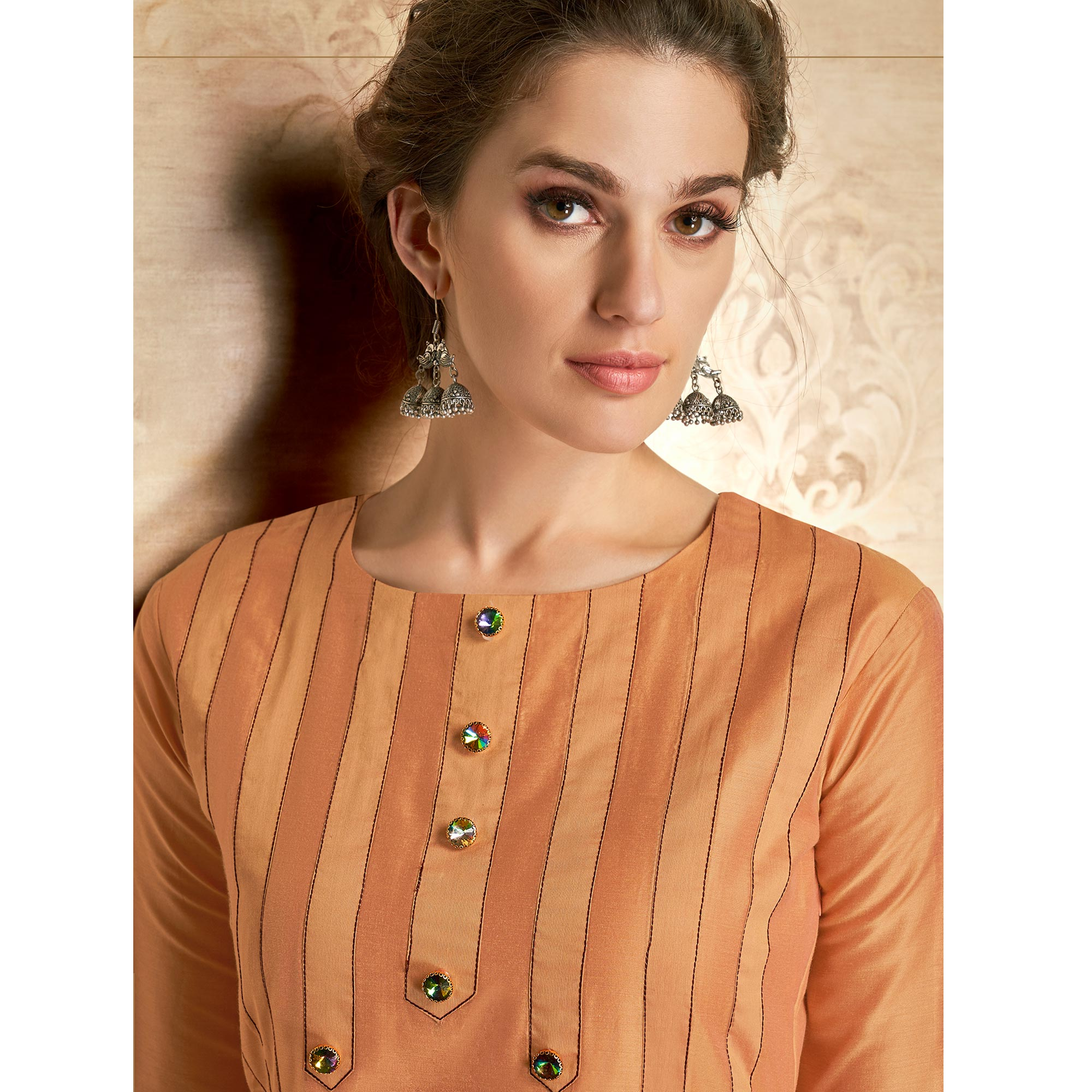 Exotic Orange Colored Partywear Embroidered Viscose Kurti