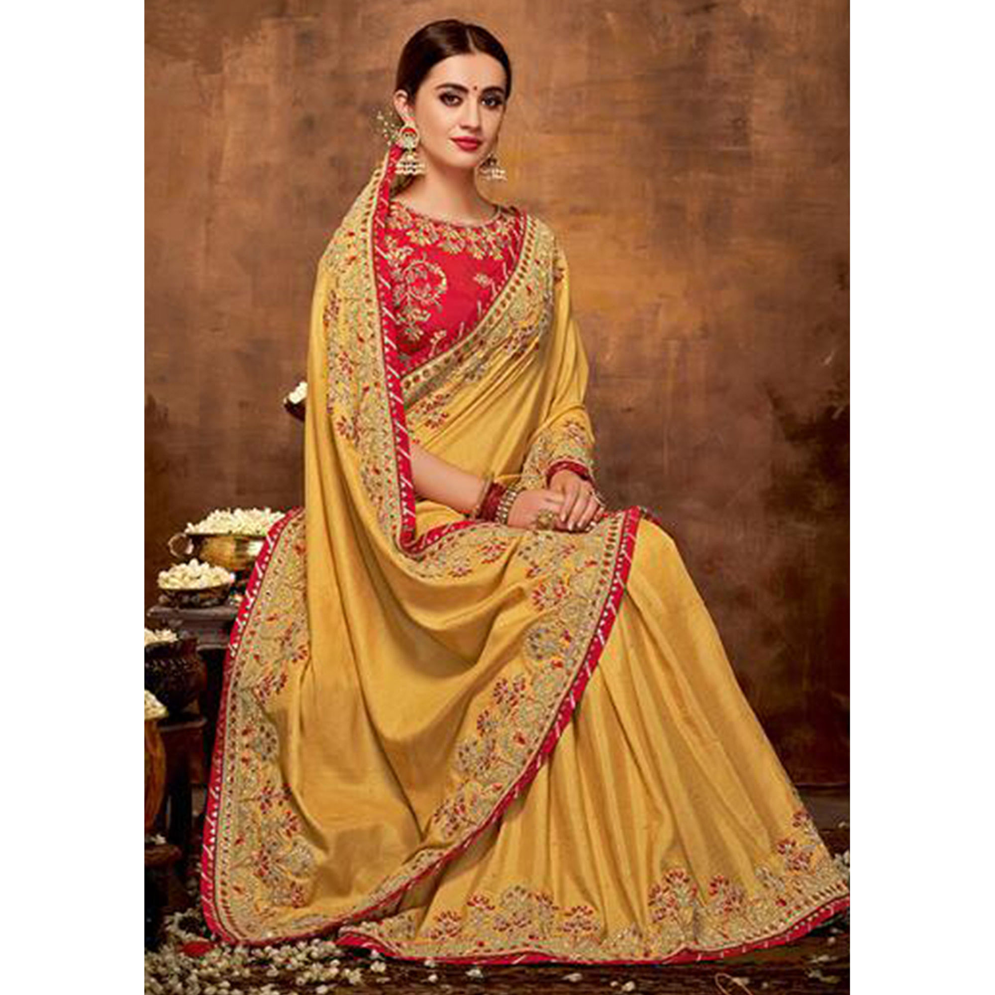 Engrossing Yellow Colored Partywear Embroidered Silk-Georgette Saree