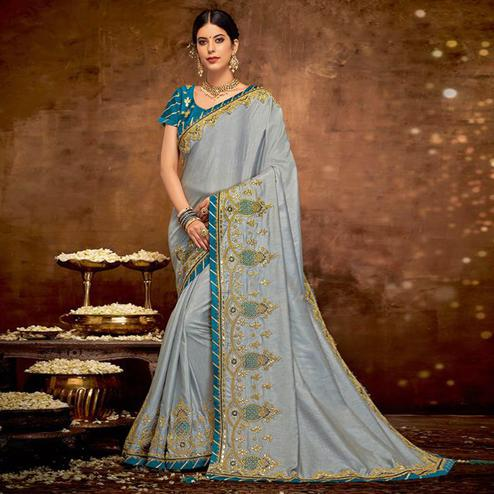 Captivating Grey Colored Partywear Embroidered Raw Silk Saree