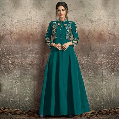 Appealing Teal Green Colored Partywear Embroidered Tapeta Silk Gown