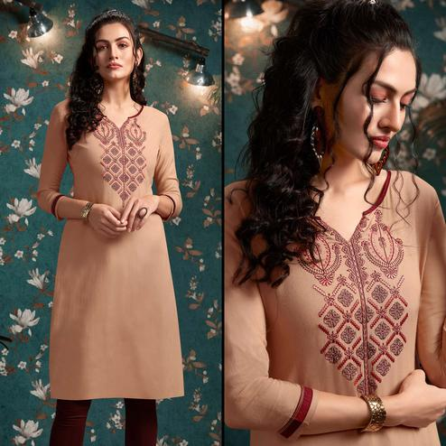 Desirable Peach Colored Casual Wear Embroidered Rayon Kurti