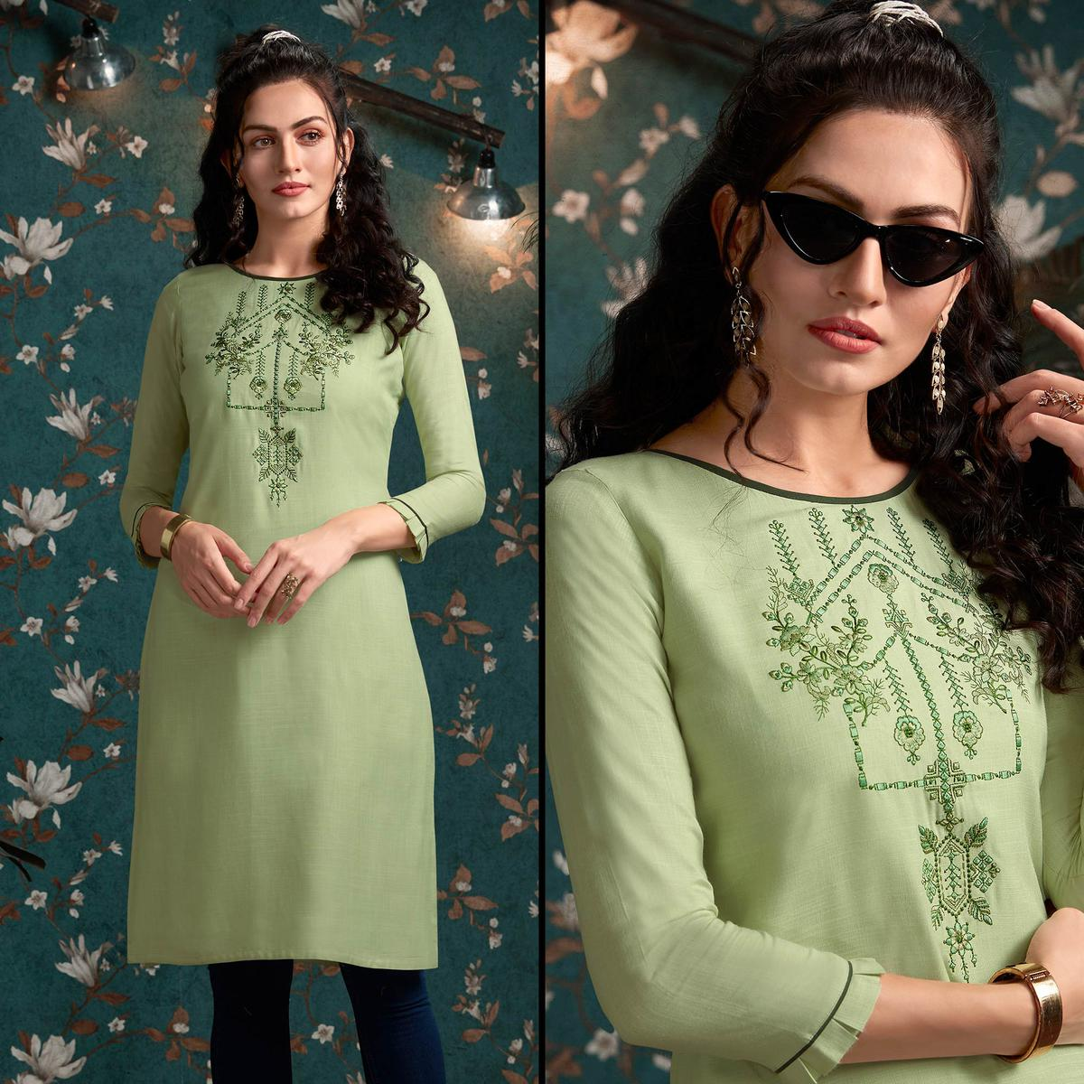Energetic Pista Green Colored Casual Wear Embroidered Rayon Kurti