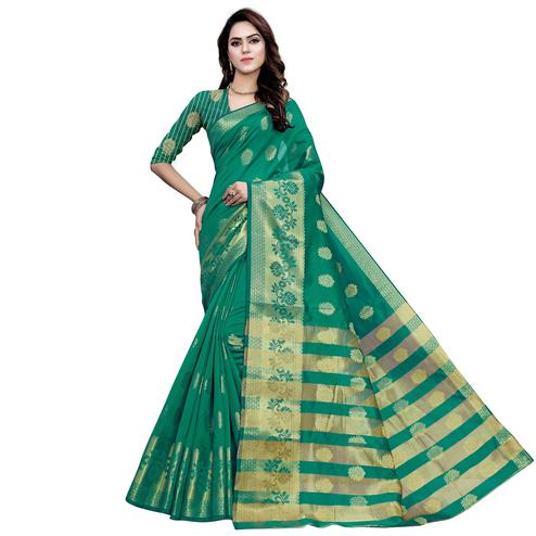 Adorning Turquoise Green Colored Festive Wear Woven Work Art Silk Saree