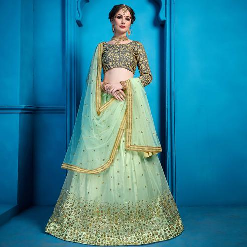 Excellent Aqua Green Colored Partywear Embroidered Netted Lehenga Choli