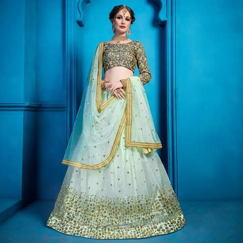 Flamboyant Sea Blue Colored Partywear Embroidered Netted Lehenga Choli
