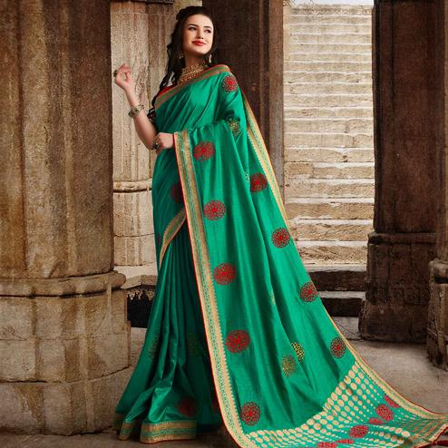 Graceful Aqua Green Colored Partywear Embroidered Silk Saree