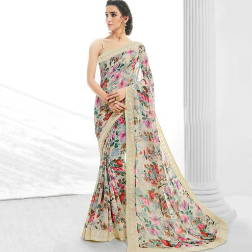 Glorious Cream Colored Partywear Printed Georgette Saree
