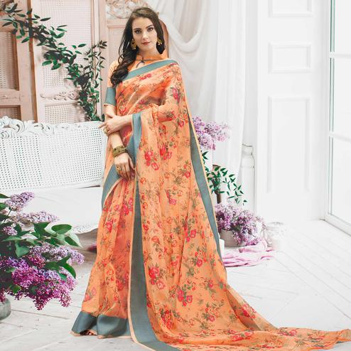 Refreshing Peach Colored Casual Wear Floral Printed Organza Saree