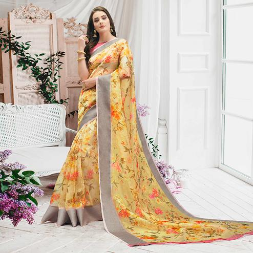 Pretty Yellow Colored Casual Wear Floral Printed Organza Saree