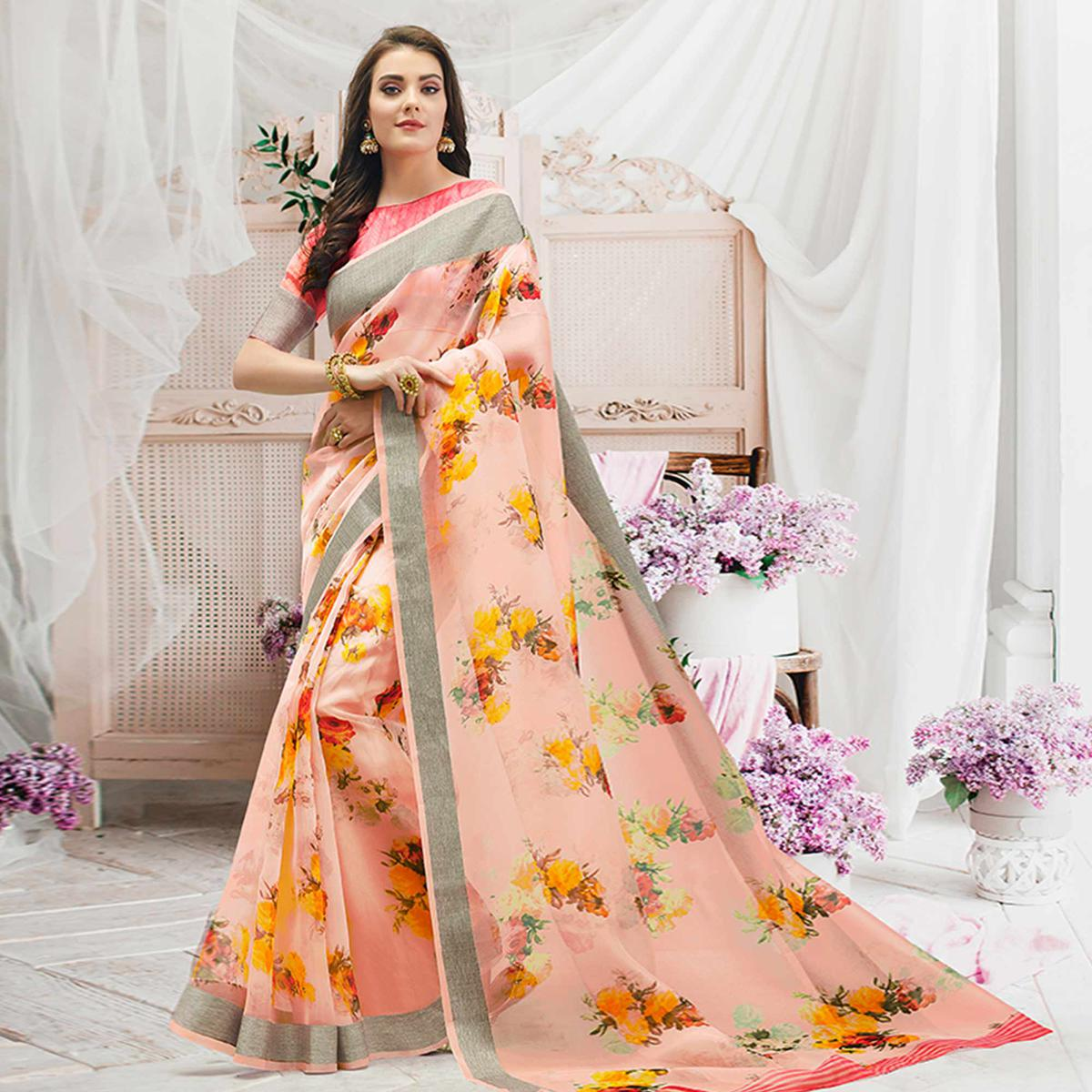 Stunning Peach Colored Casual Wear Floral Printed Organza Saree