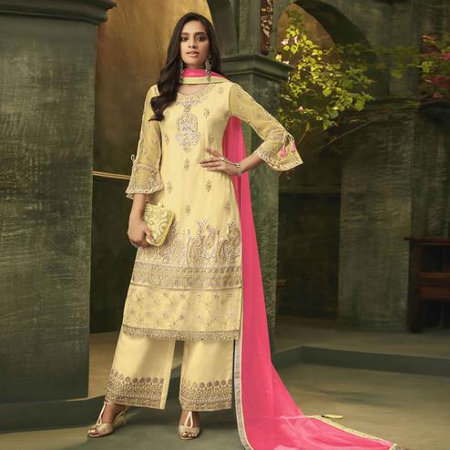 Classy Yellow Colored Party Wear Embroidered Net Palazzo Suit