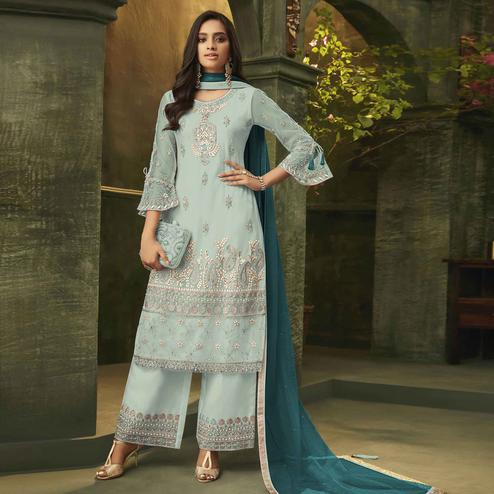 Groovy Sky Blue Colored Party Wear Embroidered Net Palazzo Suit