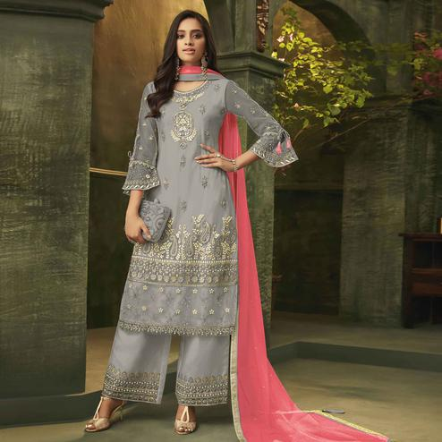 Adorning Grey Colored Party Wear Embroidered Net Palazzo Suit
