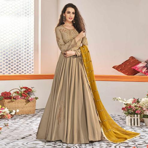Stunning Chiku Colored Partywear Embroidered Viscose Silk Anarkali Suit