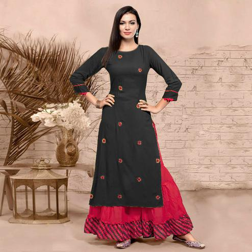 Desirable Black Colored Partywear Embroidered Rayon Kurti-Sharara Set