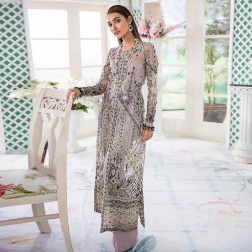 Desirable Pastel Purple Colored Party Wear Embroidered Net Palazzo Suit