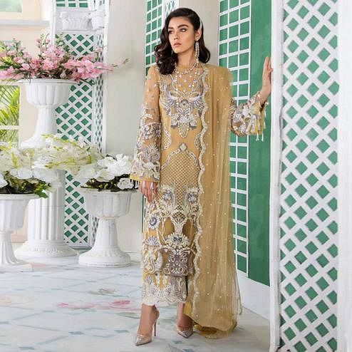 Exotic Beige Colored Party Wear Embroidered Net Palazzo Suit