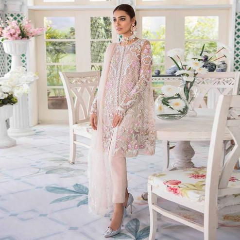 Elegant Pastel Pink Colored Party Wear Embroidered Net Pant Style Suit