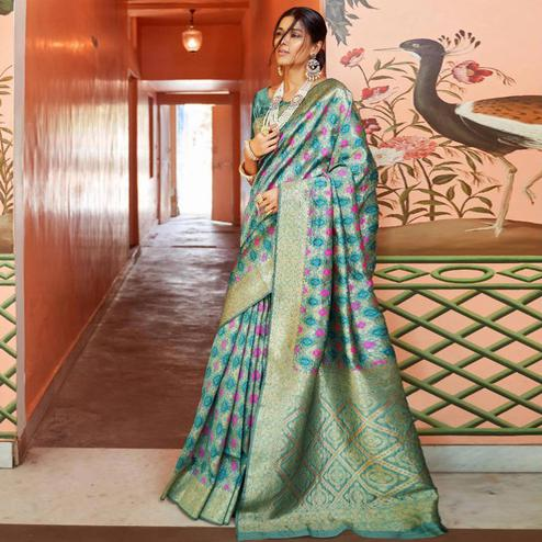 Radiant Aqua Blue Colored Festive Wear Woven Silk Saree