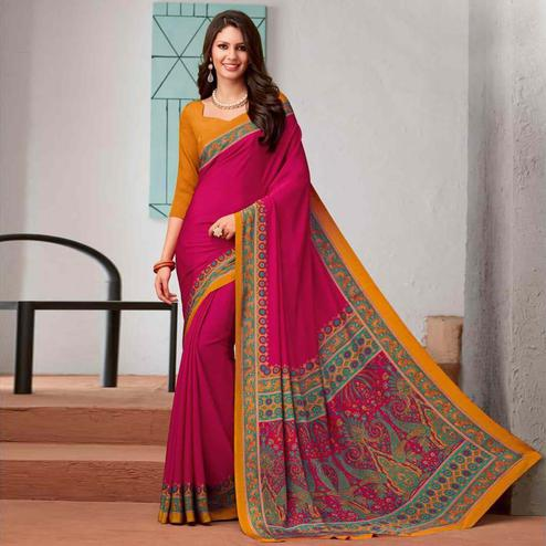 Captivating Rani Pink Colored Casual Printed Crepe Saree