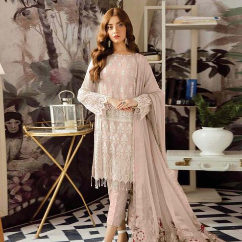 Preferable Pastel Pink Colored Partywear Embroidered Georgette Suit