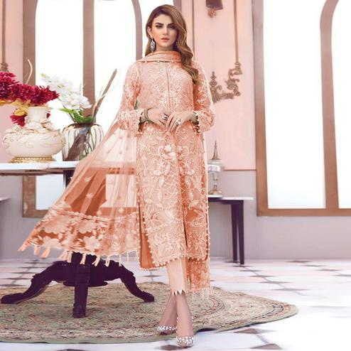 Staring Peach Colored Partywear Embroidered Netted Pant Style Suit