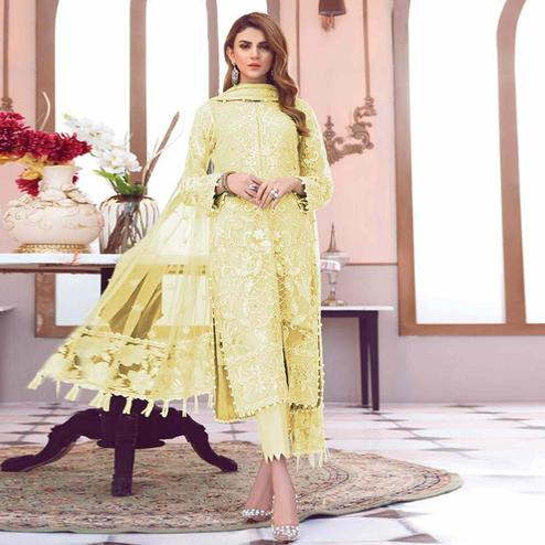 Surpassing Yellow Colored Partywear Embroidered Netted Pant Style Suit
