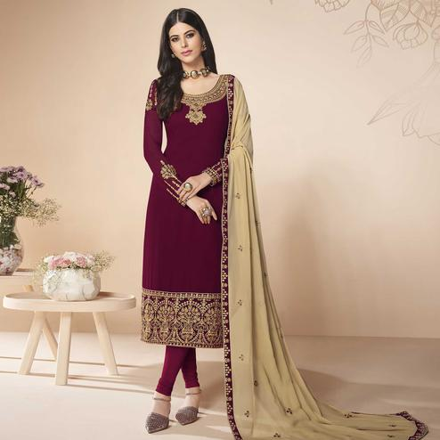 Glowing Dark Violet Colored Partywear Embroidered Faux Georgette Suit