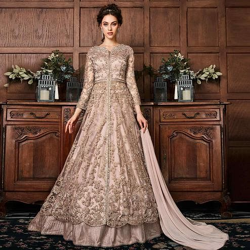 Intricate Peach Colored Partywear Embroidered Netted Anarkali Suit