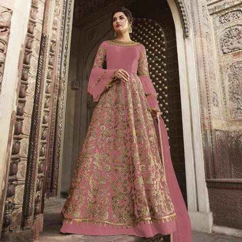 Dazzling Mauve Colored Partywear Embroidered Netted Anarkali Suit