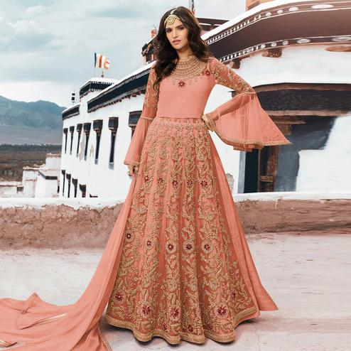 Ideal Peach Colored Partywear Embroidered Netted Anarkali Suit