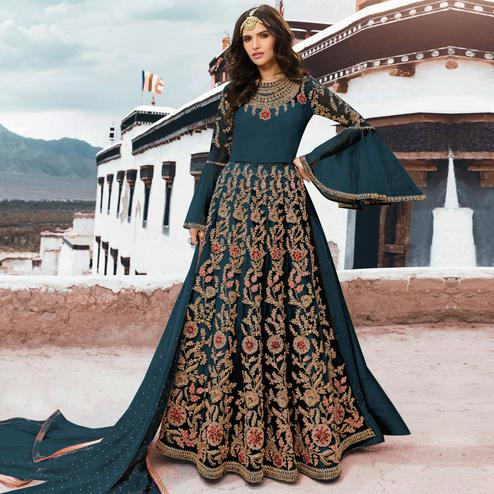Impressive Teal Blue Colored Partywear Embroidered Netted Anarkali Suit