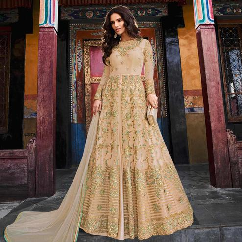 Prominent Beige Colored Partywear Embroidered Netted Lehenga Kameez